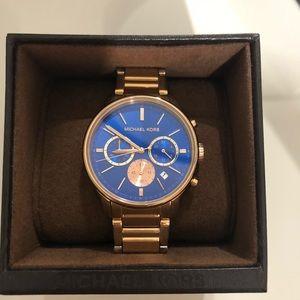 Michael Kors rose gold watch. MK5911